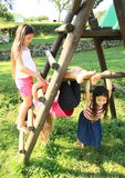 Little kids - girls playing on wooden construction stock photography