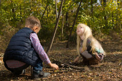 Little Kids Playing at the Woods During Autumn Royalty Free Stock Images