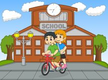 Little kids riding a bicycle in front of their school cartoon Royalty Free Stock Photography