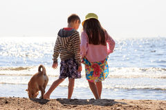 Little kids at sea water with dog. Summer. Royalty Free Stock Image