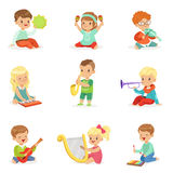 Little kids sitting and playing musical instrument, set for label design . Cartoon detailed colorful Illustrations. Little kids sitting and playing musical Stock Photo