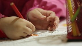 Little Kids Sitting At Table Drawing With Pencils stock footage