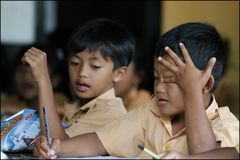 Little Kids From Slope of Merapi Mountain in Evacuation Barrack Still Studying in School royalty free stock images