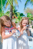 Little kids with a small turtles in hands in the reserve. Girls love cute pets so much Royalty Free Stock Image