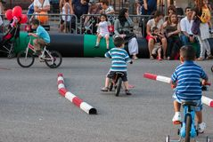 Little kids study the rules of the road traffic at street Barcelona's festival royalty free stock images