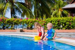Little kids in swimming pool Royalty Free Stock Image