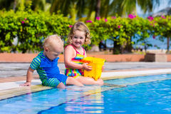 Little kids in swimming pool Royalty Free Stock Photography