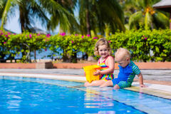 Little kids in swimming pool Stock Photos