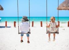 Little kids swinging stock photography