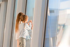 Little kids together in airport waiting for boarding near big window Royalty Free Stock Images