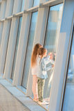 Little kids together in airport waiting for boarding near big window Stock Image