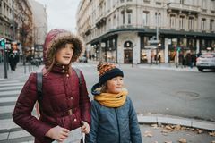 Little kids tourists. With a map walking on the street of Lyon, Frace. Travel with children Royalty Free Stock Image