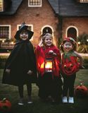 Little kids trick or treating royalty free stock photo