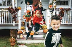 Little kids trick or treating royalty free stock image