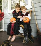 Little kids trick or treating royalty free stock photography