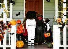 Little kids trick or treating. Ttle kids trick or treating stock photos