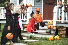 Little kids trick or treating. Ttle kids trick or treating royalty free stock photos