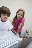 Little Kids Using Laptop Stock Photos