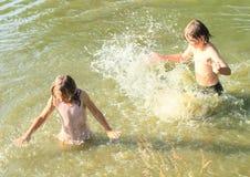 Little kids in water stock photo