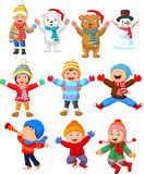 Little kids wearing winter clothes Stock Photo