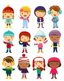 Little kids wearing winter clothes Royalty Free Stock Photos
