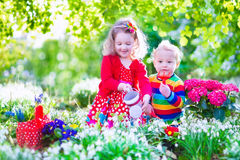 Little kids working in the garden Royalty Free Stock Photography