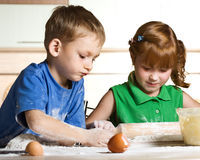 Little kitchen assistants Royalty Free Stock Image
