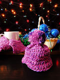 Little knitted cap. New Year composition made of mug, knitted kit and Christmas tree decorations stock images
