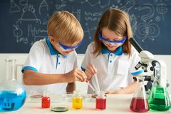 Children working in laboratory Stock Image