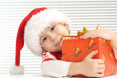 A little lad sits with a gift Royalty Free Stock Images