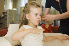 Little lady blowing her nails Royalty Free Stock Images