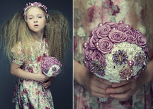 Little lady with bouquet Stock Photos