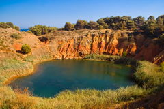 Lake near a quarry of bauxite, Italy Stock Images