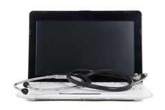 Little laptop with blank screen and stethoscope isolated on whit Stock Images