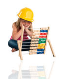 Little lassie cogitate with abacus and headpiece Stock Photos