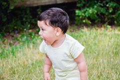 Little latin boy shouting outdoors. Royalty Free Stock Photo