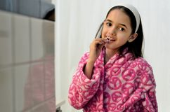 Little Latin Girl Flossing Stock Photography