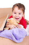 Little laughing boy in a cardboardbox Stock Photo