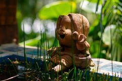 Little laughing buddha in a garden Stock Photo