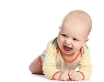Little laughing crawling baby on white. Cute little laughing crawling baby isolated on white royalty free stock photos