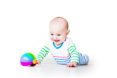 Little laughing funny baby boy learning to crawl Stock Images
