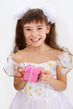 Little laughing girl holding christmas present Stock Image