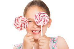 Little laughing  girl holding colorful lollipop Stock Images
