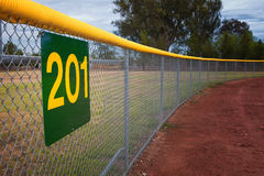Little League Baseball Fence. With a distance marker sign stock images