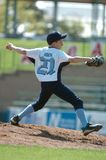 Little league Baseball. Pitcher making the throw to the batter with power and speed stock photos