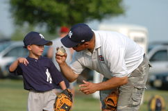 Little League Baseball. Little league manager giving instructions to his pitcher stock photo