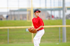 Youth baseball pitcher in red jersey Royalty Free Stock Photos