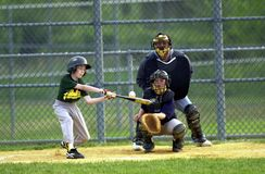 Little league Baseball. Player making connection with the baseball royalty free stock images