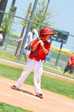 Youth baseball player with wood bat. Royalty Free Stock Photography