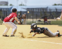 Little League Baseball. Slide into base Royalty Free Stock Photo